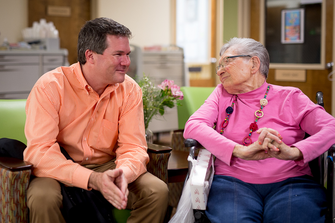 Larsen Jay chatting with older patient