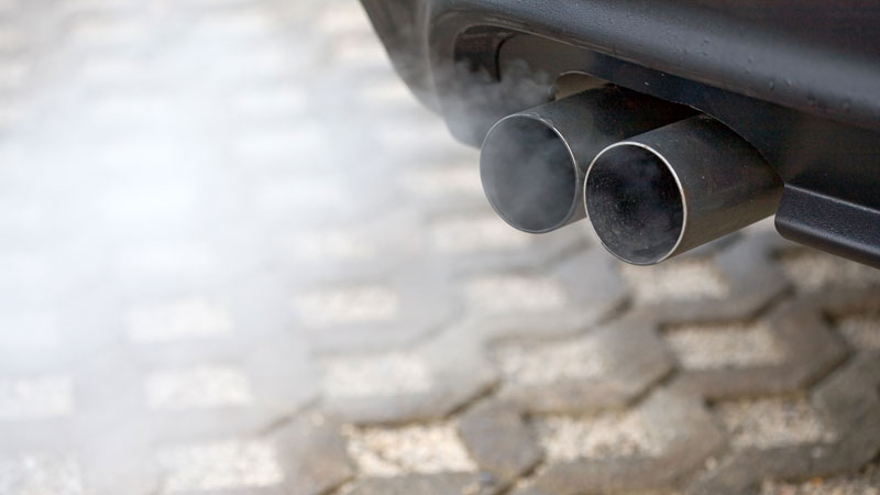 car blowing white smoke from the exhaust