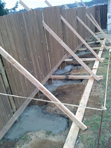 Straighten fence and add footings
