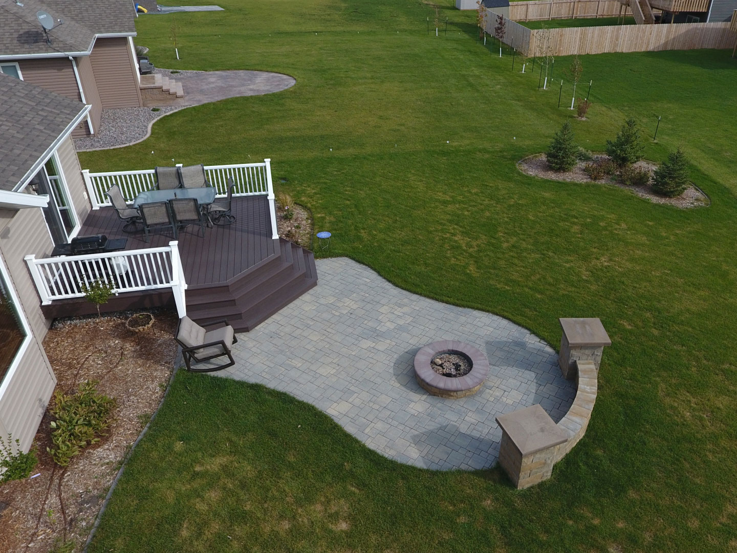 raised deck to patio with fire pit and