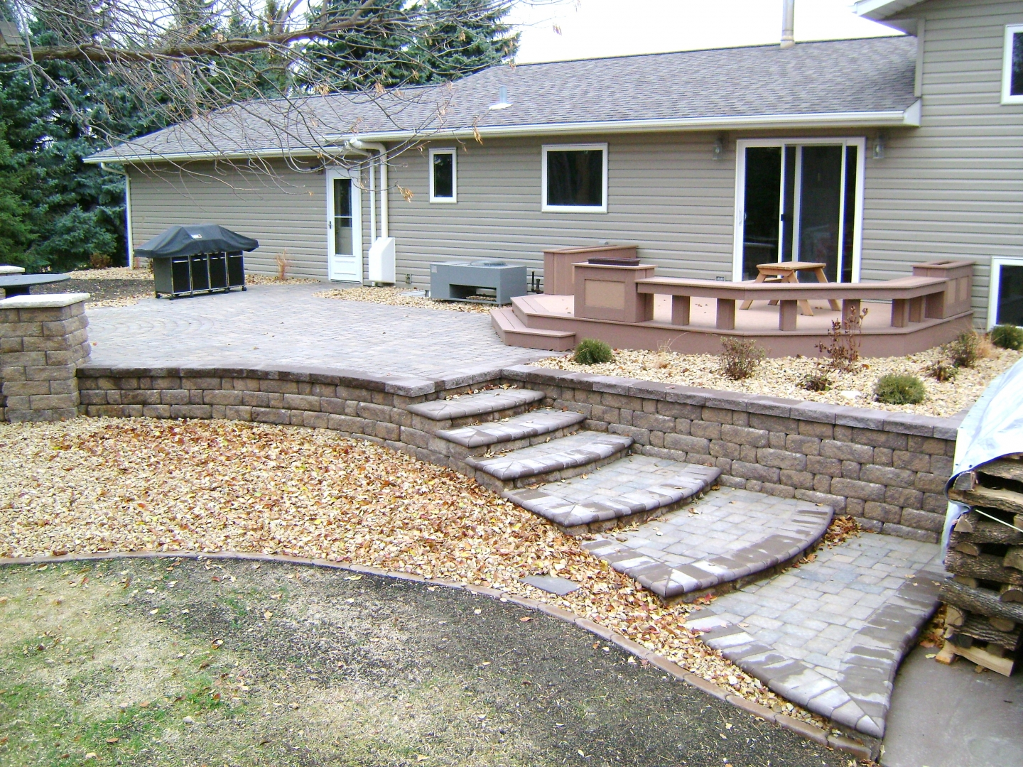Backyard Fire Pit with Seat Wall and Paver Patio - Oasis ... on Raised Concrete Patio Ideas id=75397