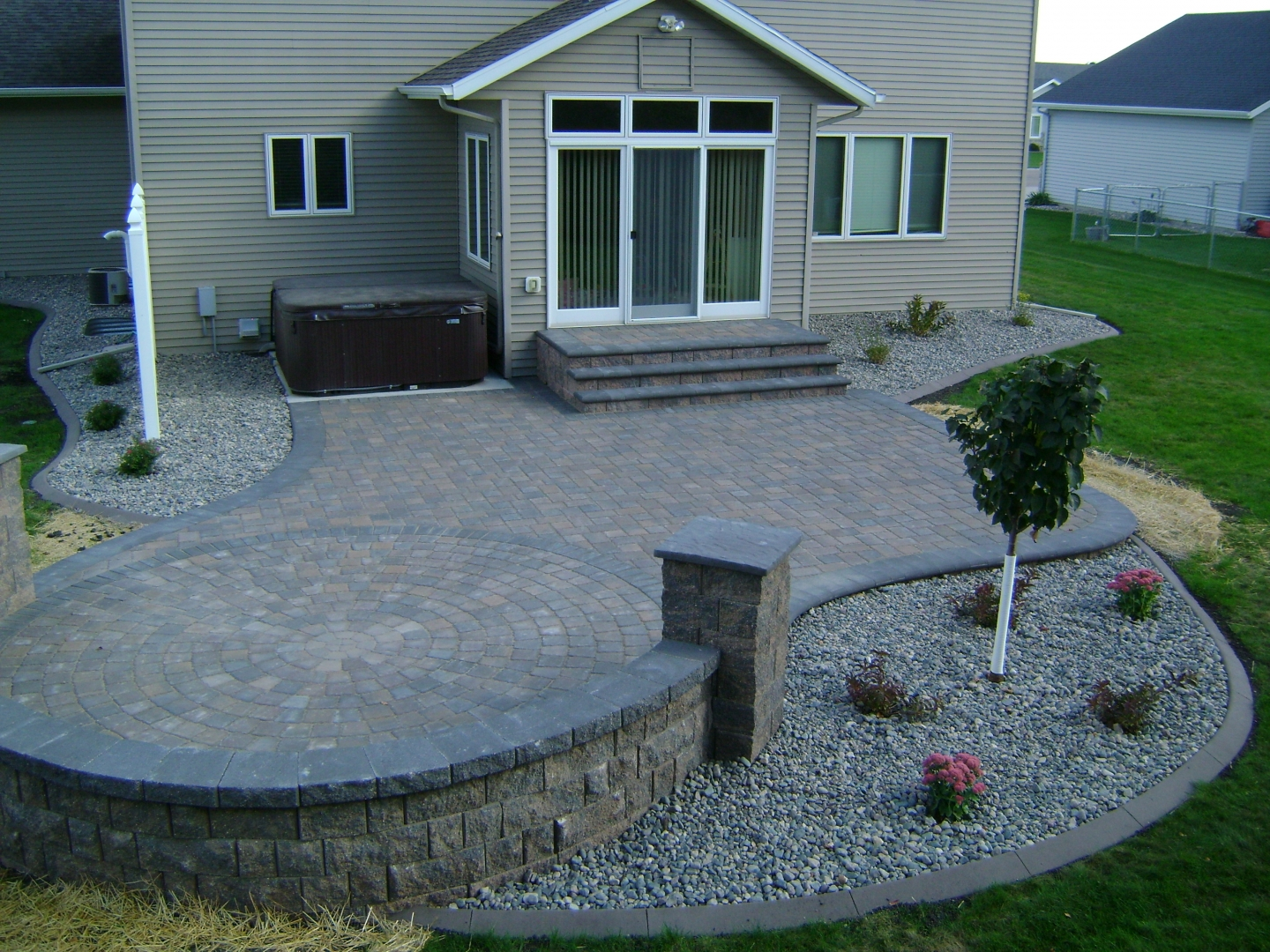 Earth Tone Paver Patio with Sitting Wall and Rock Fill ... on Patio Block Wall Ideas id=73505