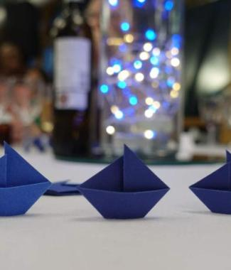 Origami-Sailboat-Wedding-Party-Table-Scatters-Confetti-Handmade-Royal-Blue-closeup-Oast-House-Gifts