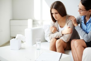 Woman being counseled as a mental health patient might