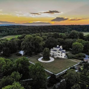 Oatlands drone picture showing the mansion and grounds at sunset.