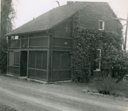 black and white photo of the two-story Bacelor's Cottage in 1951