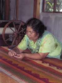 dolores-chavez-cleaning-rug.jpg