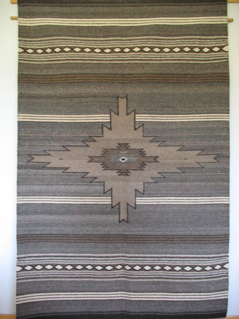 Old sarape design, now a floor rug