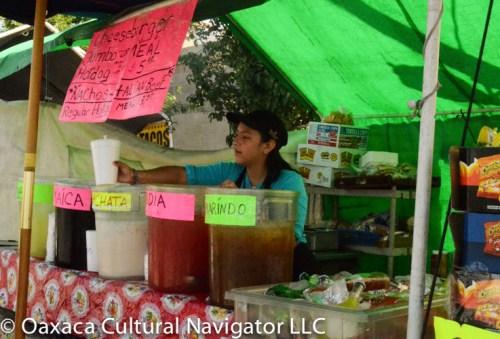 Serving horchata and aguas de tamarindo, sandia, jamaica