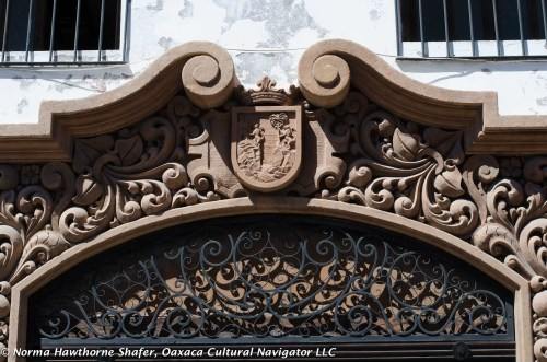 Hand carved colonial wood detailing on doorway arch