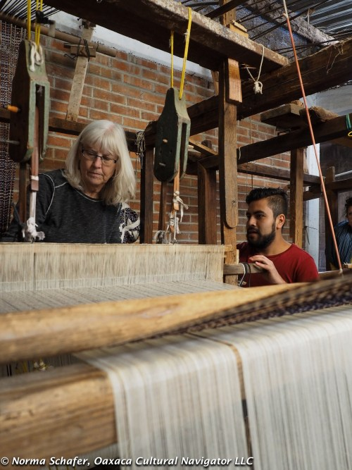 Cindy, a North Carolina weaver, tries the pedal loom with Jesus' son Hugo