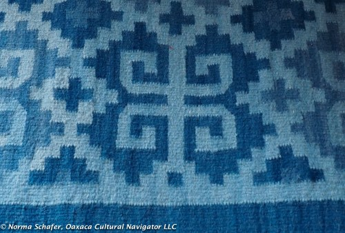 Handwoven indigo rug with greca design