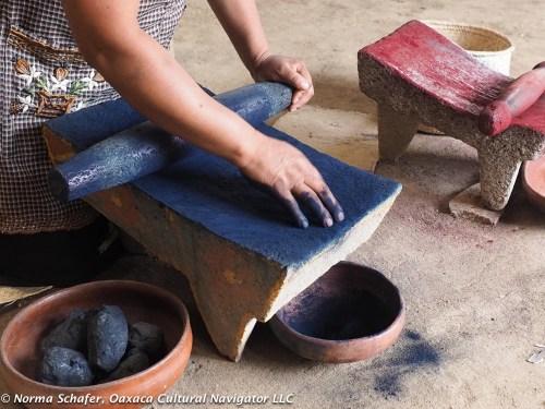 Preparing indigo for the dye pot -- first crush it to powder