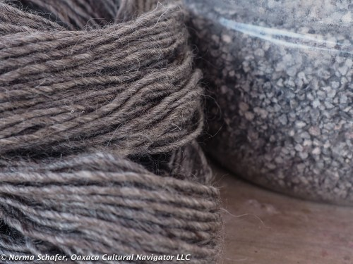 Natural grey wool and dried cochineal bugs.