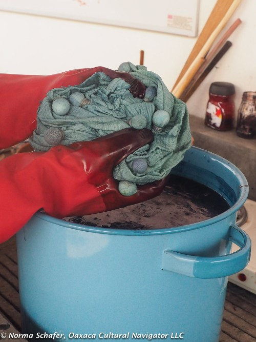 Rhiannon's shibori scarf comes out of the indigo dye bath