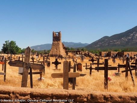 Cemetery, Taos Pueblo, with adobe chapel