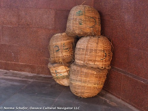 Woven baskets at the Agra train station. What's inside?