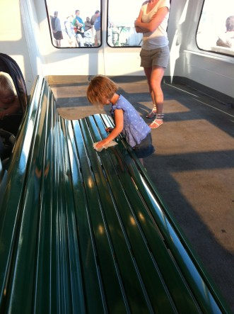 then got back on the ferry. It was too cold for E outside, so she cleaned the seats for everyone.
