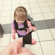 Careening through the airport on our way home. This little one is just as good a traveler as her sister these days.