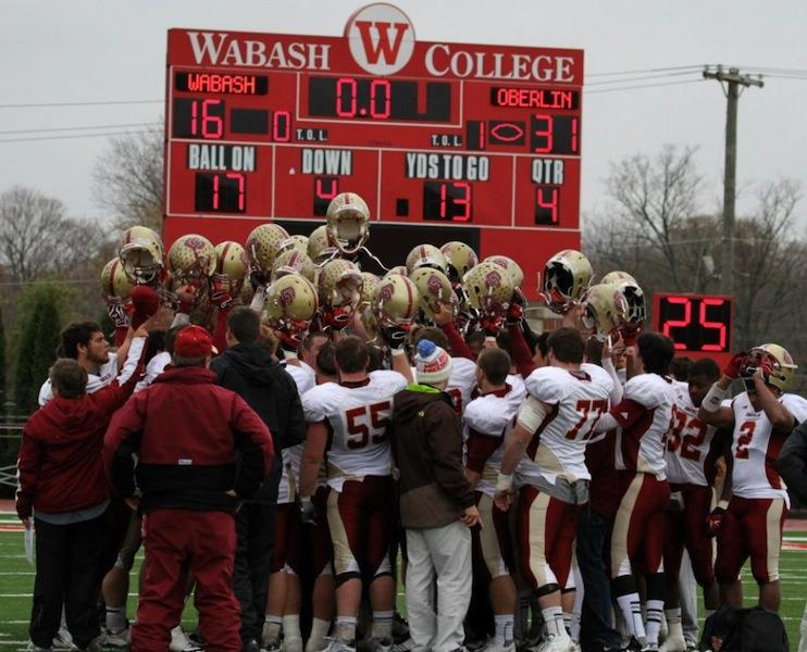 The+Yeomen+celebrate+their+historic+victory+over+Number+10+Wabash+University+this+past+weekend.+Oberlin+defeated+the+Little+Giants+31-16+in+a+classic+David+and+Goliath+upset.