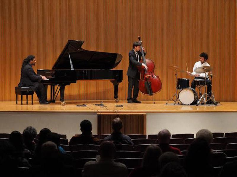 From+left%2C+Conservatory+senior+Shea+Pierre+on+the+piano%2C+double-degree+fifth-year+Daniel+Pappalardo+on+bass+and+Conservatory+senior+Miles+Labat+on+drums+perform+Pappalardo%E2%80%99s+original+composition%2C+Over+the+Curve.+Their+performance+was+part+of+the+Danenberg+Honors+Recital%2C+which+showcased+the+top+talent+from+the+Conservatory.+