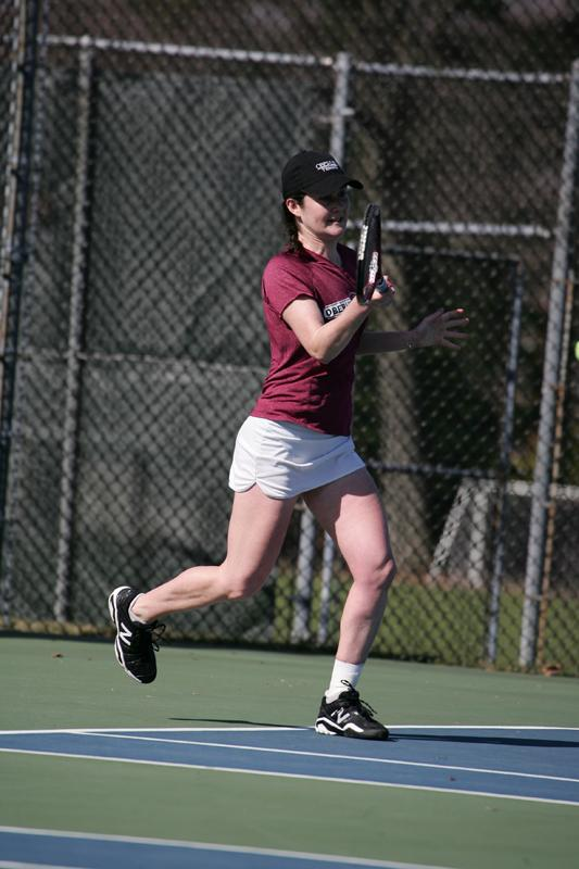 Senior+Brenna+Sheldon+eyes+the+ball+in+a+match.+Sheldon+boasts+an+impressive+21%E2%80%936+singles+record+and+20%E2%80%937+in+dou-+bles.+She+recently+earned+a+bid+to+the+NCAA+Division+III+ten-+nis+tournament.