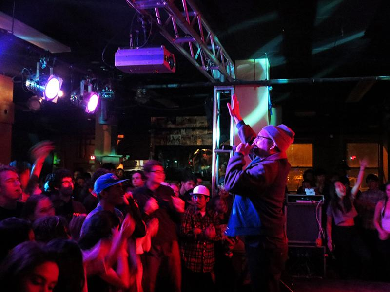 An energetic crowd claps and dances at the Blue Scholars 'Sco concert last Friday evening. The Seattle-based hip-hop duo sang about social justice and peace at a successful performance sponsored by the Asia America Art Collective.