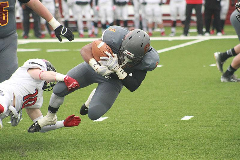First-year+running+back+Khalil+Rivers+is+tackled+by+an+Ohio+Wesleyan+defender.+Though+the+Yeomen%0Afell+50%E2%80%9313+to+the+Battling+Bishops%2C+Rivers+managed+42+yards+on+15+carries.