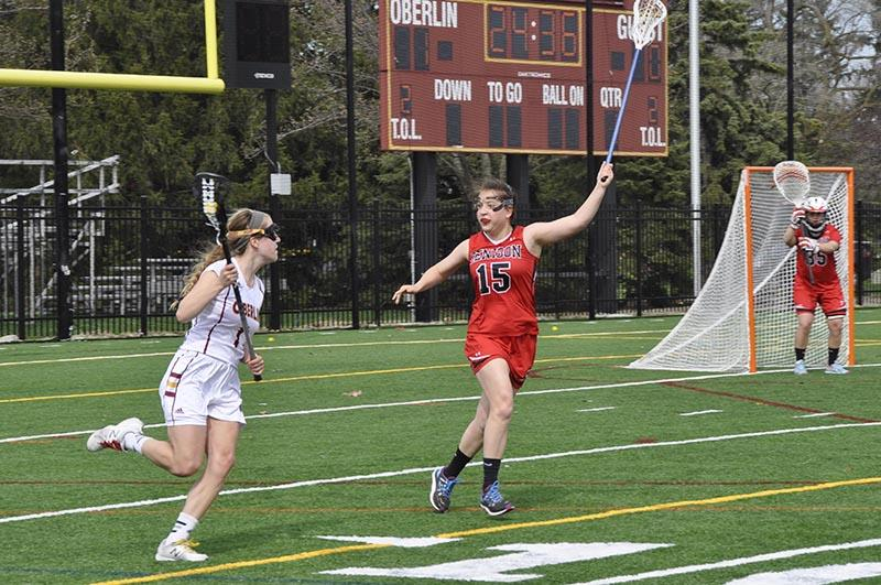 Senior+co-captain+Bronwen+Schumacher+takes+on+a+Denison+University+Big+Red+defender+last+Saturday+at+the+Austin+E.+Knowlton+Athletic+Complex.+Schumacher%2C+co-captain+Kate+Hanick+and+classmate+Jodi+Helsel+were+all+honored+in+the+team%E2%80%99s+Senior+Day+ceremony+prior+to+the+game.