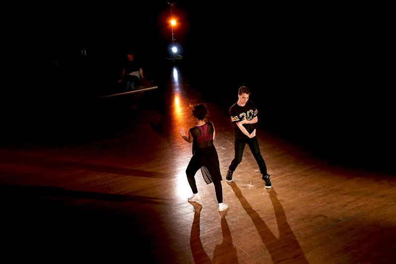 College sophomore Kalei Tooman and College senior Olivia Jones-Hall mirror one another's moves during the Stu- dent Dance Showcase. The performance, which took place last Friday and Saturday, included a wide variety of acts, from breakdancing to ballet.