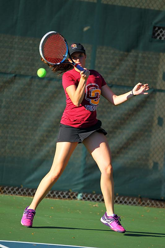 Sophomore Jackie McDermott forehands a shot back at her opponent. McDermott and her team triumphed over Division II Walsh University on Friday, but fell to Division I Cleveland State on Saturday.