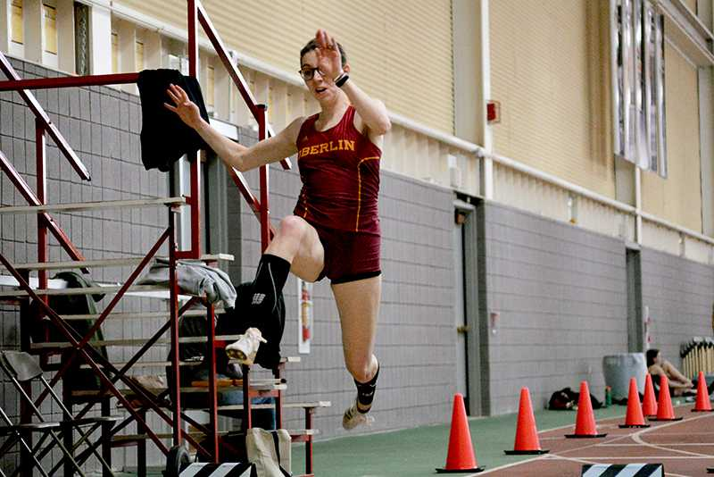 Sophomore Annie Goodridge vaults over the sand pit during a triple jump. Goodridge's firstplace 11-meter jump was one of many highlights for the men's and women's track teams at the Bob Kahn Invitational at Oberlin.