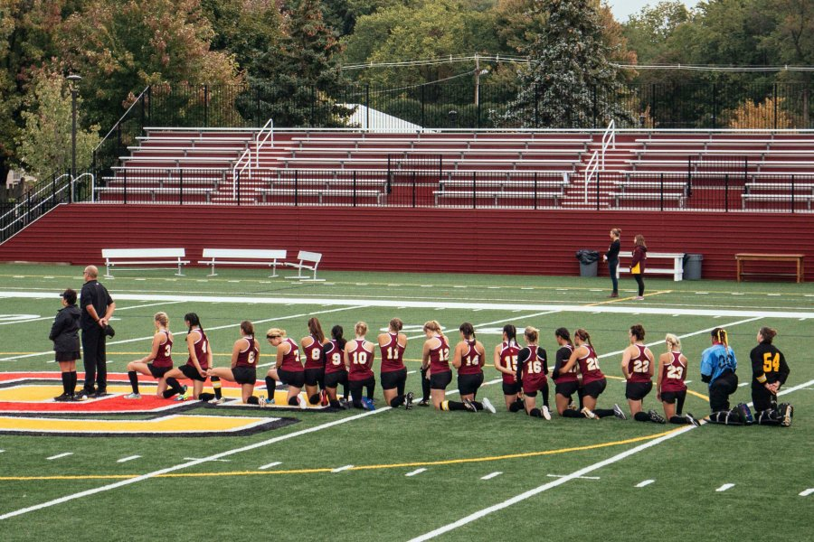 The+Yeowomen+kneel+during+the+national+anthem+before+facing+off+against+NCAC+foe+Denison+University+last+Thursday.+