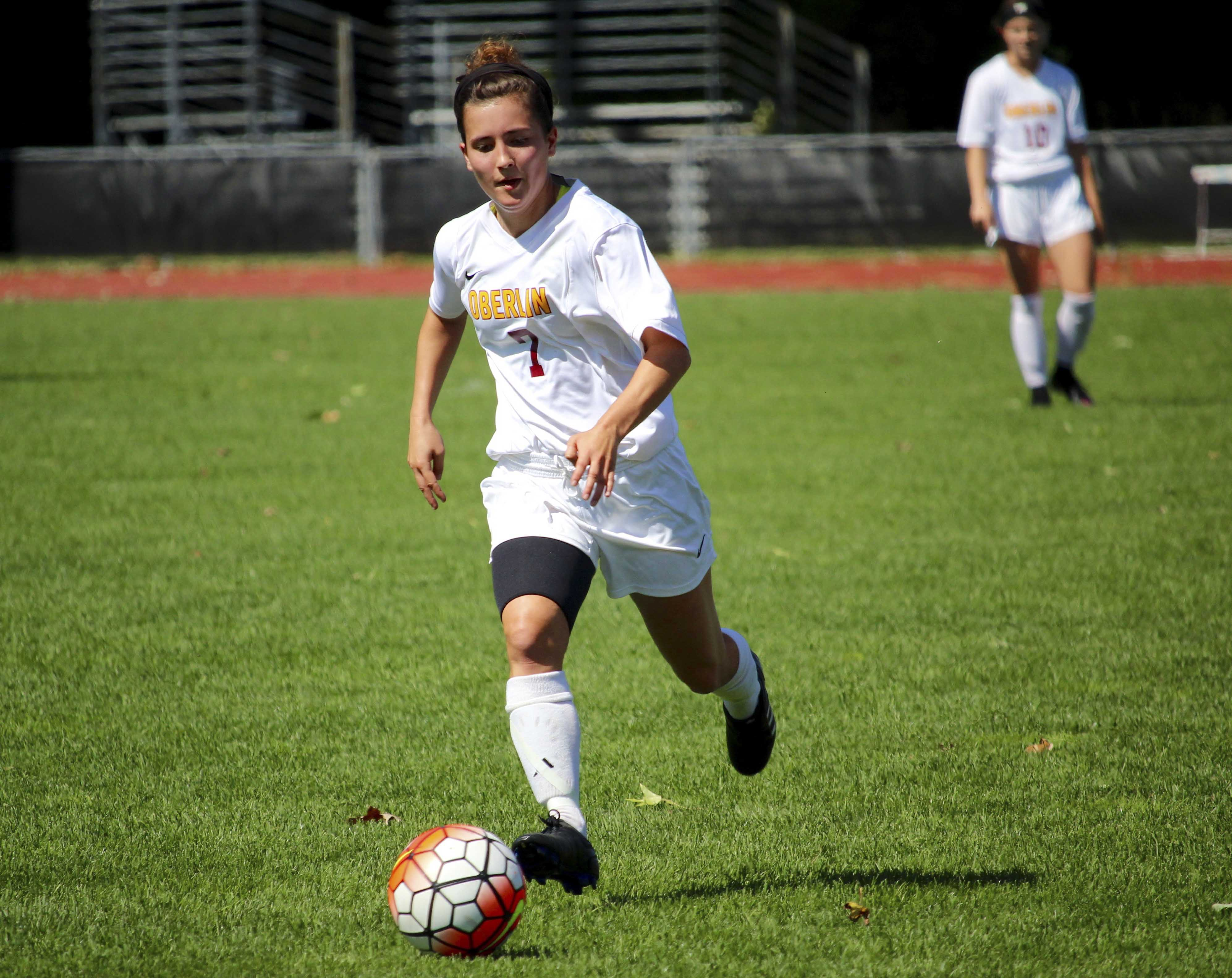 Senior defender Casey McGuire dribbles the ball across the field. After an 8–0 win over Defiance College on Sept. 11, the Yeowomen have a 3–2 record.