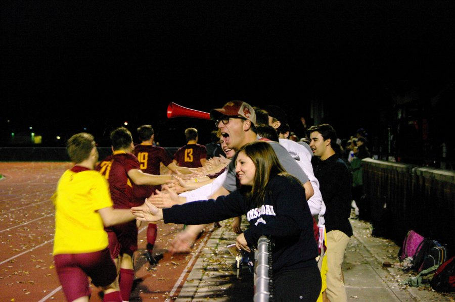 Fans+congratulate+the+Yeomen+after+their+2%E2%80%931+NCAC+semifinal+victory+over+Wabash+College.+The+victory+propelled+the+team+to+its+first+conference+championship+match+in+school+history.