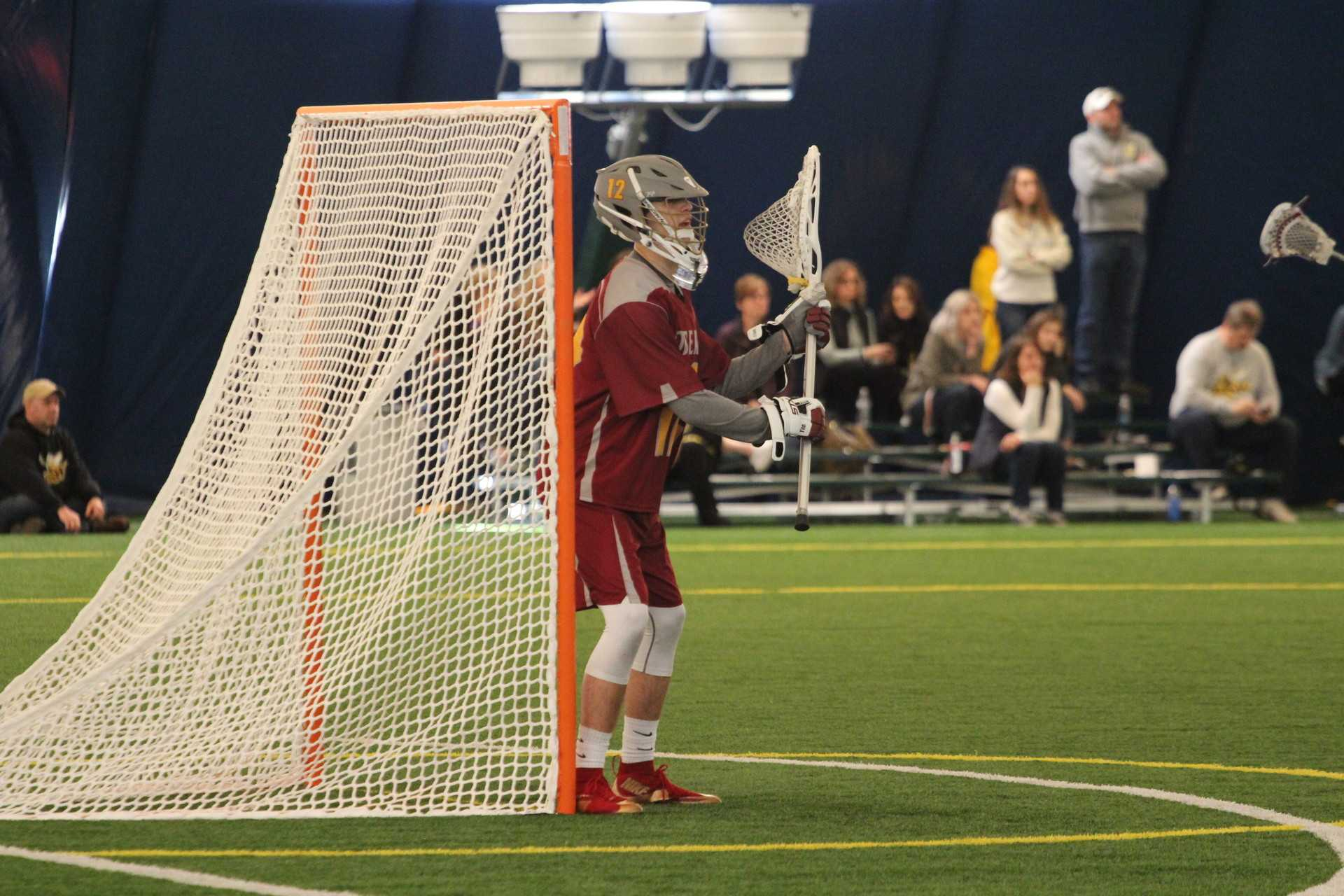 First-year Calvin Filson plays goalie against the Baldwin Wallace University Yellow Jackets. Last weekend, Oberlin dropped its first two games of the 2017 season.