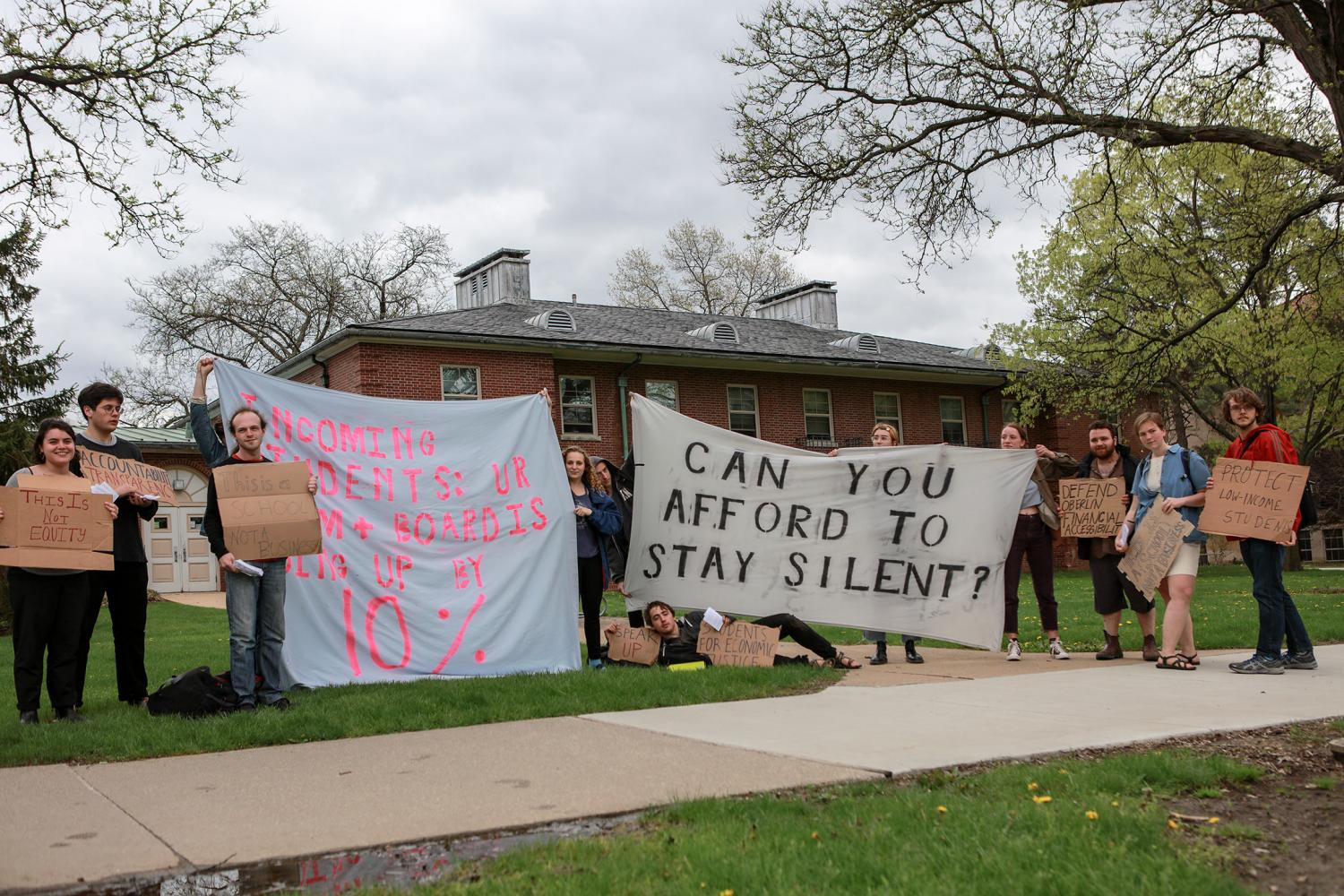 Students protest against the administration's new housing, dining and OSCA financial aid policies last Friday. The protest was one of many actions in opposition to the changes, leading to today's meeting between OSCA officers and the administration.