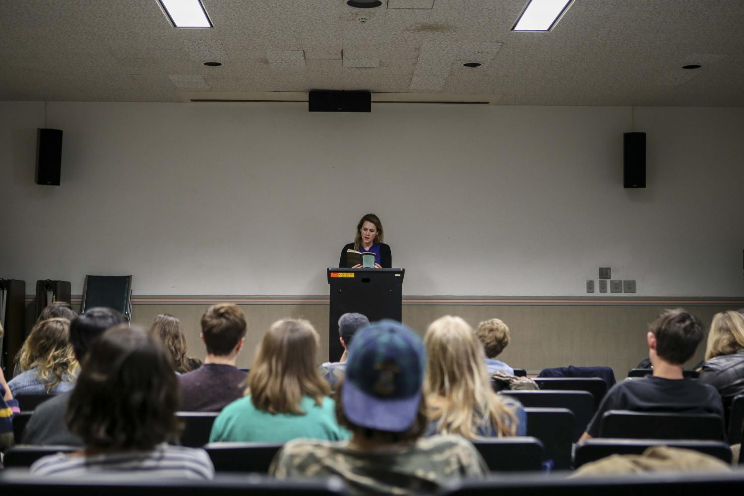 Poet, editor, and assistant professor of English at Cleveland State University Caryl Pagel reads to an audience in Wilder Hall. Pagel came to Oberlin Wednesday to give a poetry reading in which she debuted several new works.