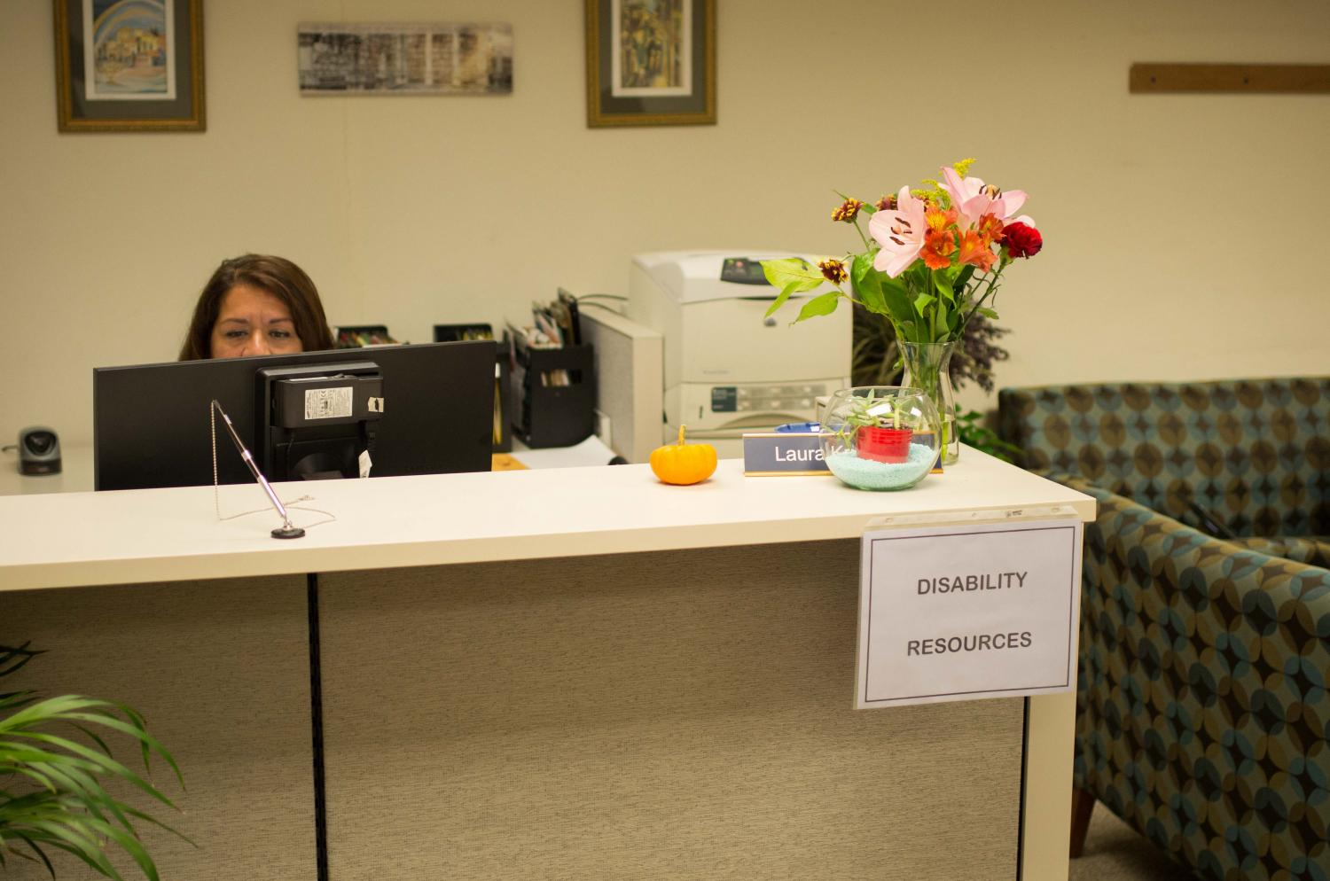 Office of Disability Resources Administrative Assistant Laura Krupelak works at her desk. The ODR's interim director Isabella Moreno, OC '94, resigned Monday, leaving the Office understaffed.