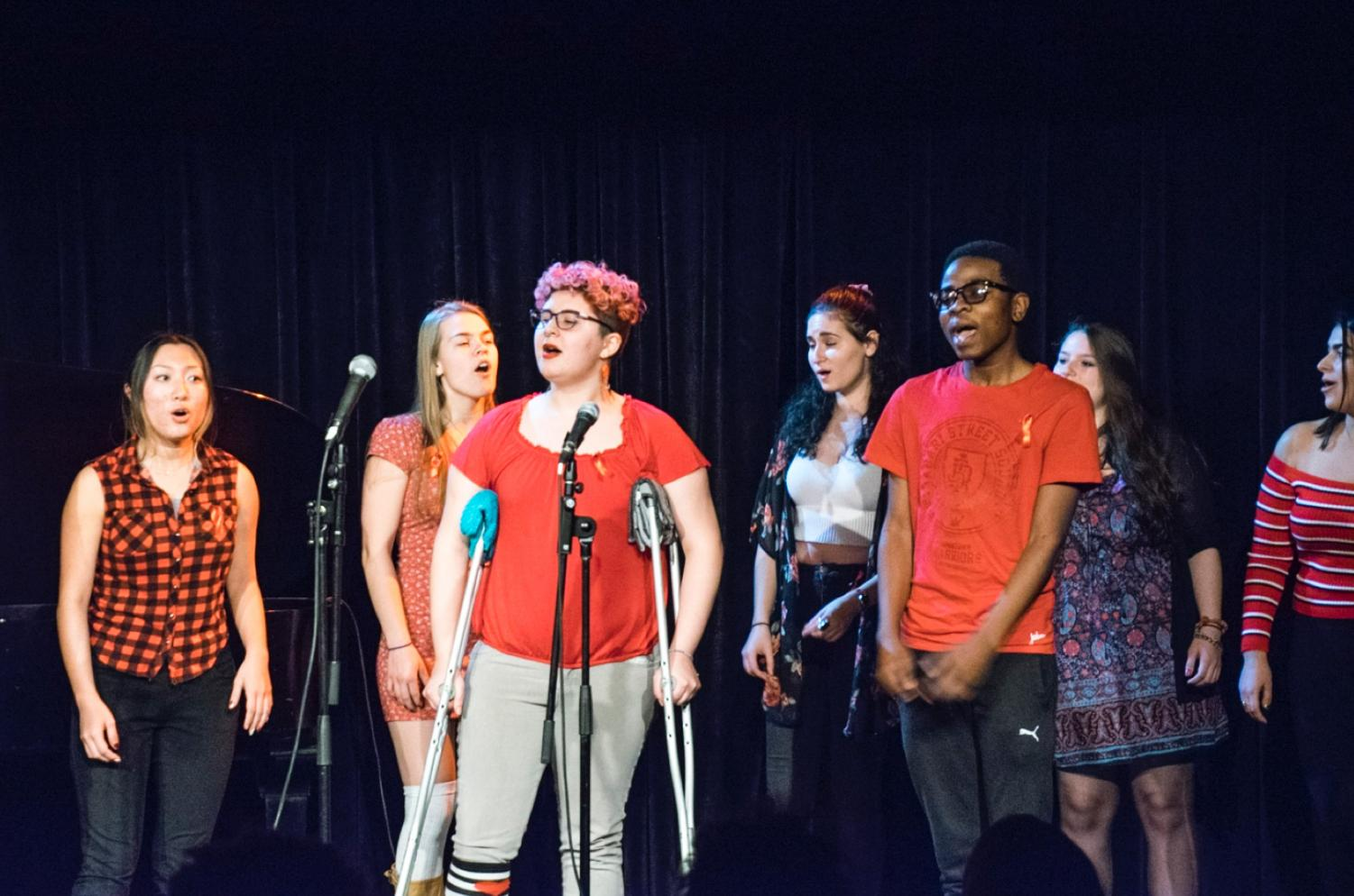 "Students perform on stage at the Cat in the Cream on Dec. 1, as part of a series of performances to commemorate World AIDS Day. The event, titled ""Music, Healing & Celebration of Life,"" was dedicated ""in memory of all those who lost their lives to AIDS, in celebration of all those living despite"" and featured The Obertones, OSLAM, and Pitch Please, as well as a variety of individual performers."