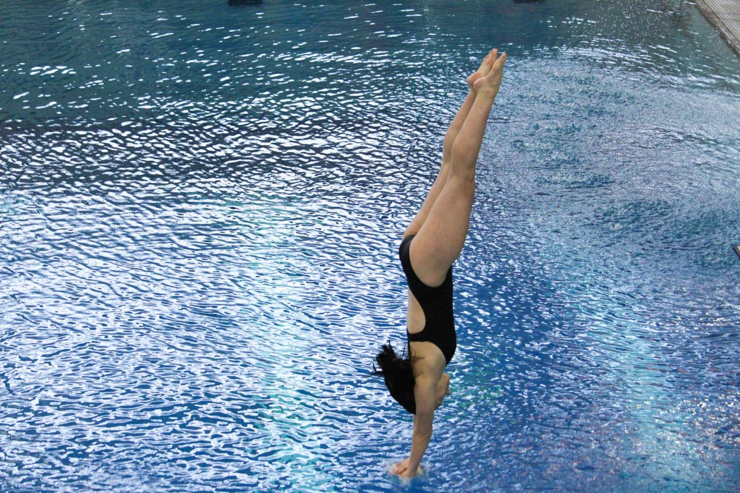 College senior Rachael Andrews dives her way to an eighth-place finish in the three-meter diving at the NCAC Swimming and Diving Championships last week.