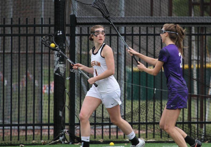 Senior+midfielder+Sydney+Garvis+attempts+to+rifle+the+ball+past+a+Kenyon+College+Ladies+defender+on+senior+day.+The+Yeowomen+ended+their+season+last+Wednesday+against+the+College+of+Wooster+Fighting+Scots+in+the+NCAC+semifinals.