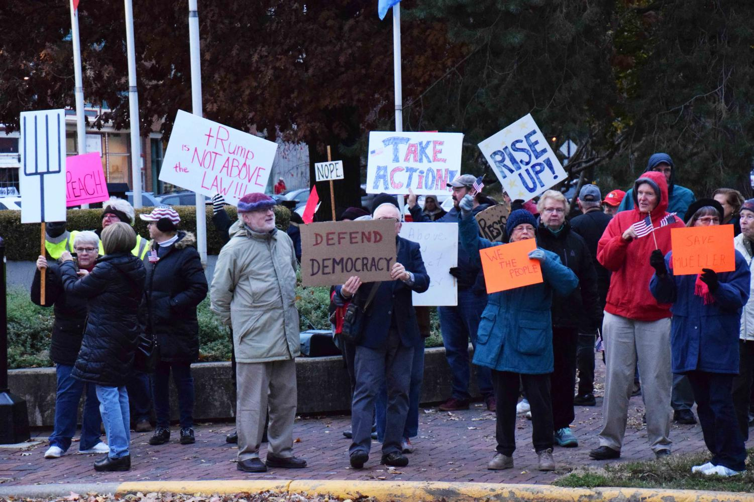 """Protestors participate in a """"Nobody is Above the Law"""" rally in Tappan Square."""