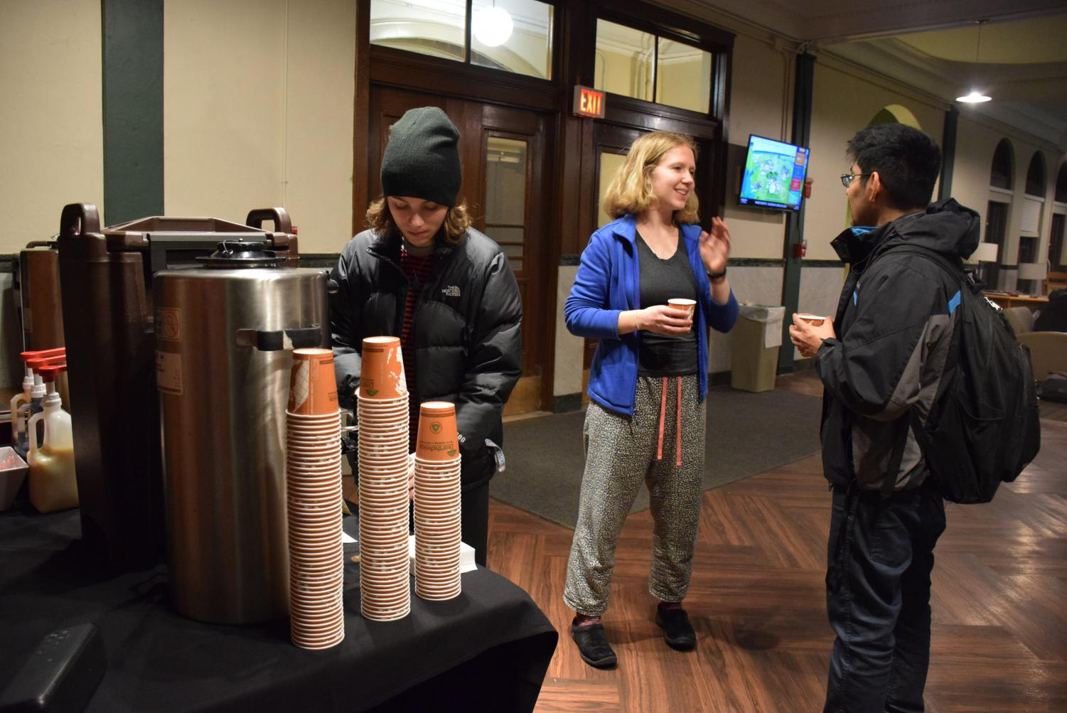 "Students fill their cups with hot cocoa at the Constituents Week event ""Hot Chocolate with Ambar"" Monday, Dec. 3 in Wilder Hall."