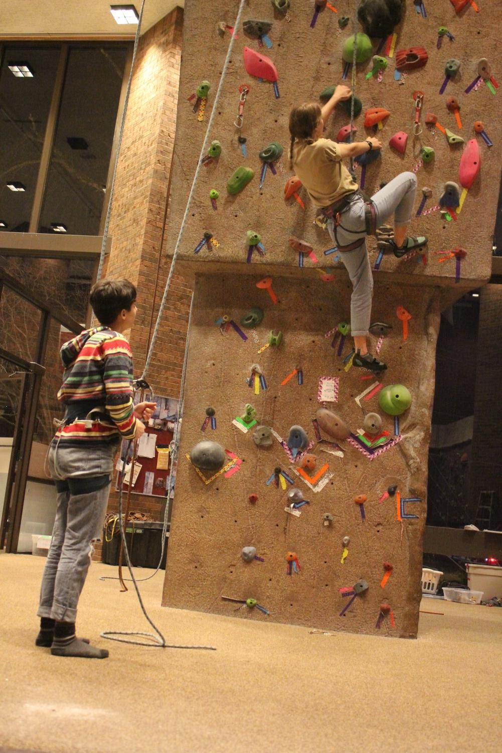 College fourth-year Julia Butler and College first-year Mira Newman at the Oberlin College Climbing Wall.
