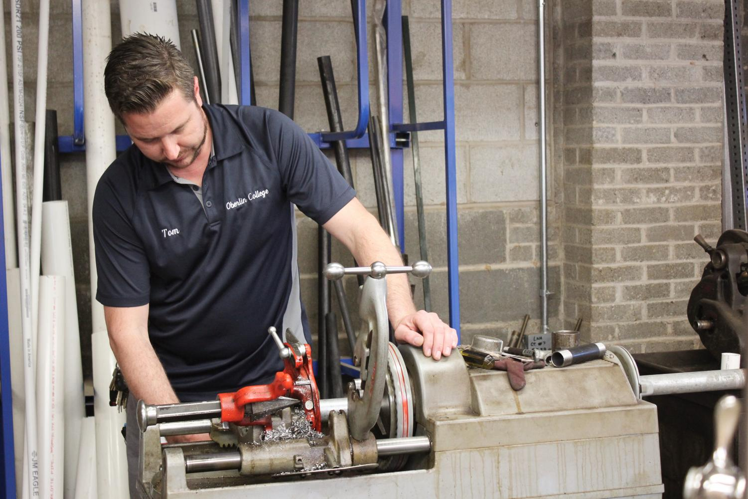 College plumber and United Auto Workers member Tom Wright works in Facilities Operations on campus