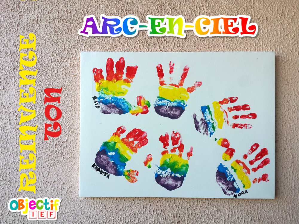 Arc-en-ciel d'empreintes de petites mains à la peinture Objectif IEF