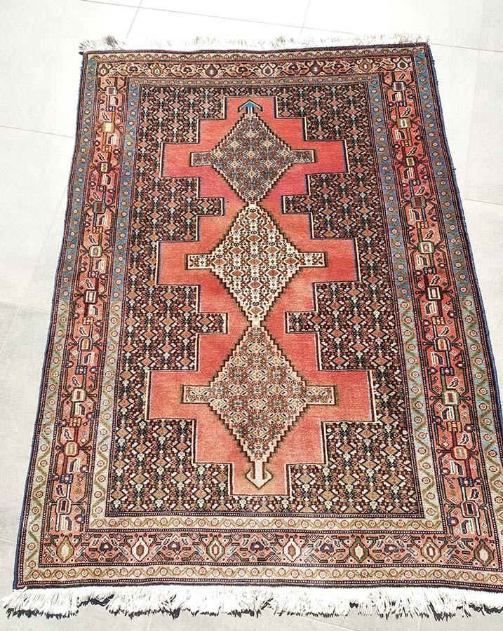 tapis persan en laine fait main