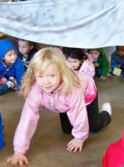 children crawling under blanket - The Very Hungry Caterpillar Gross Motor Activity