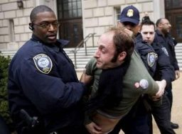 Arrested in front of the IRS building, March 19 2008, REUTERS/Joshua Roberts (UNITED STATES)